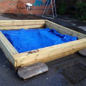 Building the sandpit at Allen Edwards School